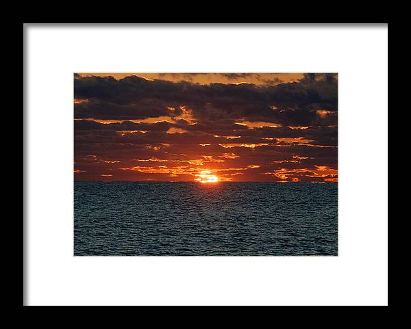 Sun Framed Print featuring the photograph Into The Sea by Justin Robertson