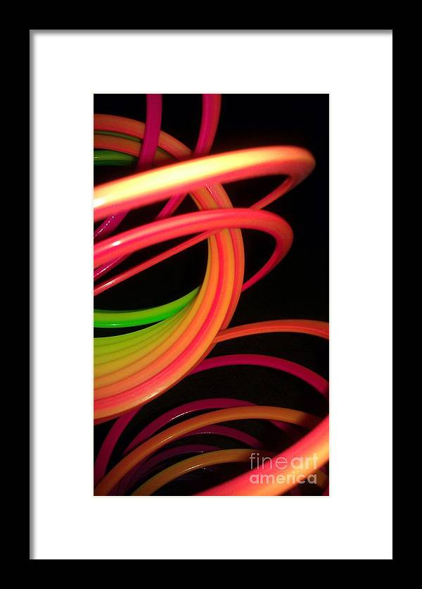 Slinky Framed Print featuring the photograph Its Fun For A Girl And A Boy by Paulina Roybal