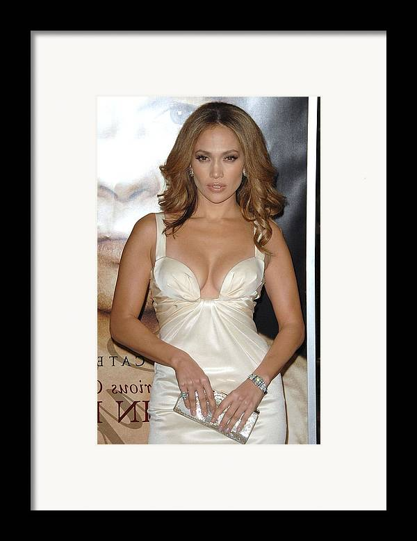 The Curious Case Of Benjamin Button Premiere Framed Print featuring the photograph Jennifer Lopez Wearing A Roberto by Everett