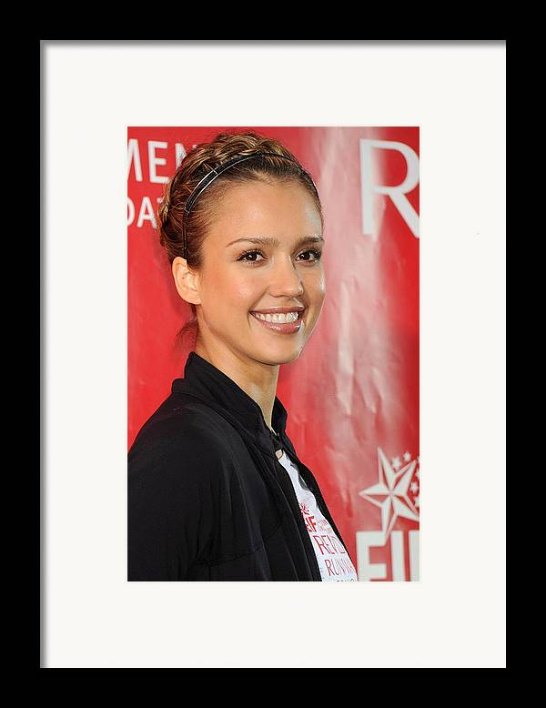 Jessica Alba Framed Print featuring the photograph Jessica Alba At A Public Appearance by Everett