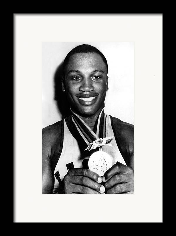 Boxer Framed Print featuring the photograph Joe Frazier Holding Olympic Heavyweight by Everett