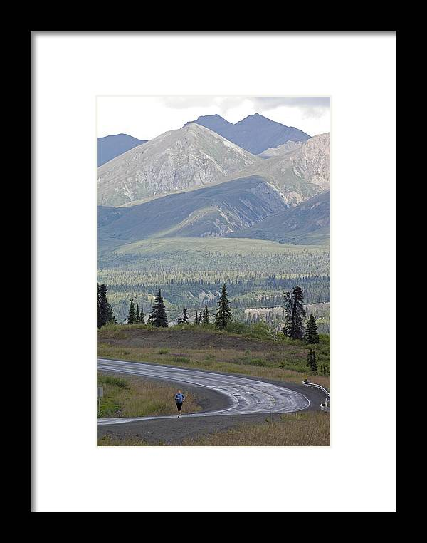 Joggers Framed Print featuring the photograph Jogger On The Glenn Highway And Chugach by Rich Reid