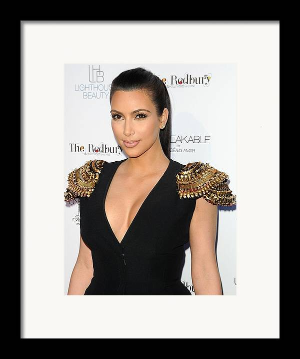 Kim Kardashian Framed Print featuring the photograph Kim Kardashian Wearing An Alexander by Everett
