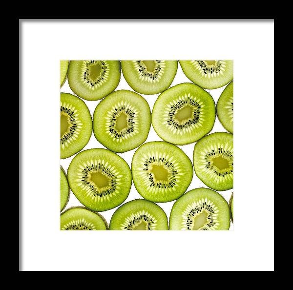 Kiwi Framed Print featuring the photograph Kiwi Slices by Mark Sykes