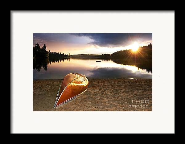 Canoe Framed Print featuring the photograph Lake Sunset With Canoe On Beach by Elena Elisseeva