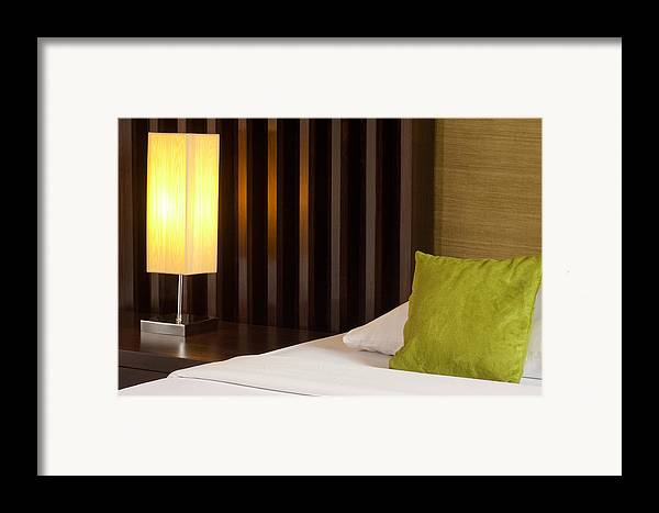 Hotel Framed Print featuring the photograph Lamp And Bed by Atiketta Sangasaeng