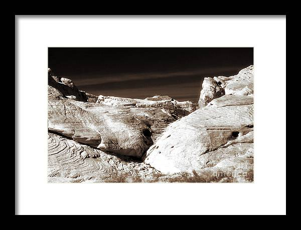 Landing In The Desert Framed Print featuring the photograph Landing in the Desert by John Rizzuto