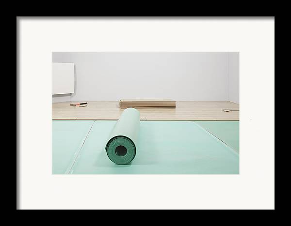 Nobody Framed Print featuring the photograph Laying A Floor. A Roll Of Underlay Or by Magomed Magomedagaev