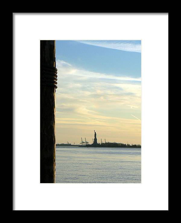 Statue Of Liberty Dusk Evening Outline Dock Quay Framed Print featuring the photograph Liberty From Afar by Loreena Rick