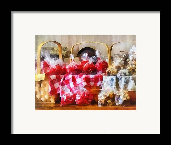 Candy Framed Print featuring the photograph Licorice And Chocolate Covered Peanuts by Susan Savad
