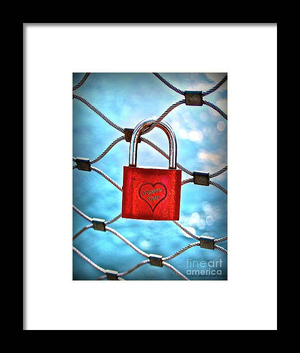 A Padlock On A Bridge Fence In Salzburg Austria Framed Print featuring the photograph Locked In It Together by Taylor Steffen SCOTT