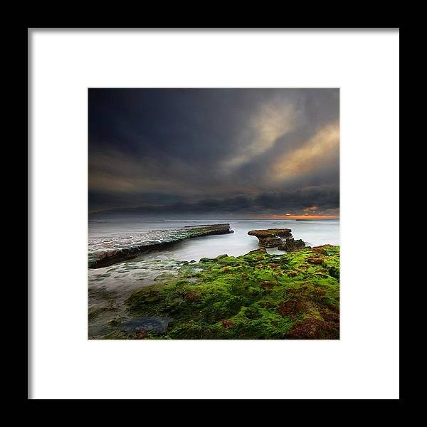 Framed Print featuring the photograph Long Exposure Of A Stormy Sunset At A by Larry Marshall