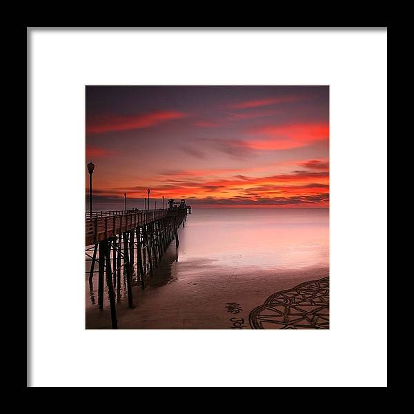 All_sunsets Framed Print featuring the photograph Long Exposure Sunset At The Oceanside by Larry Marshall