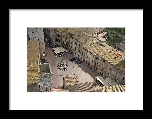 Aerial View Framed Print featuring the photograph Looking Down On The Red Tile Rooftops by Keenpress