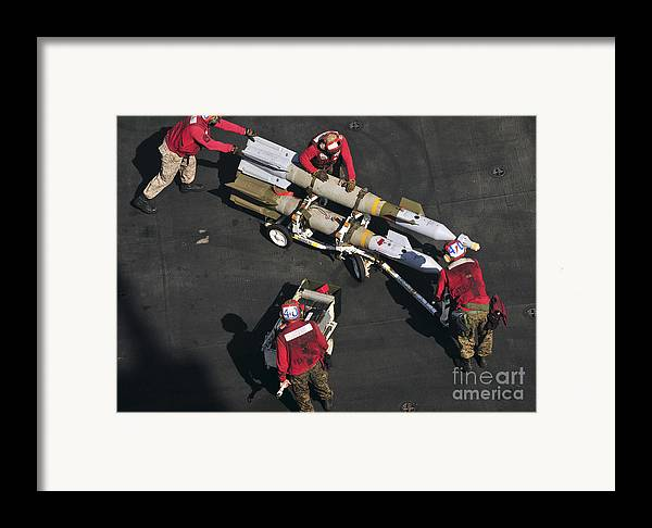 Marines Framed Print featuring the photograph Marines Push Pordnance Into Place by Stocktrek Images