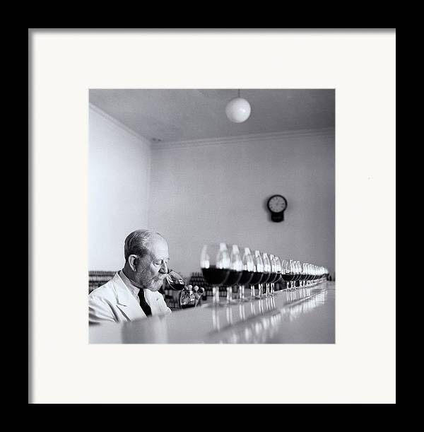 55-59 Years Framed Print featuring the photograph Mature Wine Tester With Row Of Glasses (b&w) by Hulton Archive