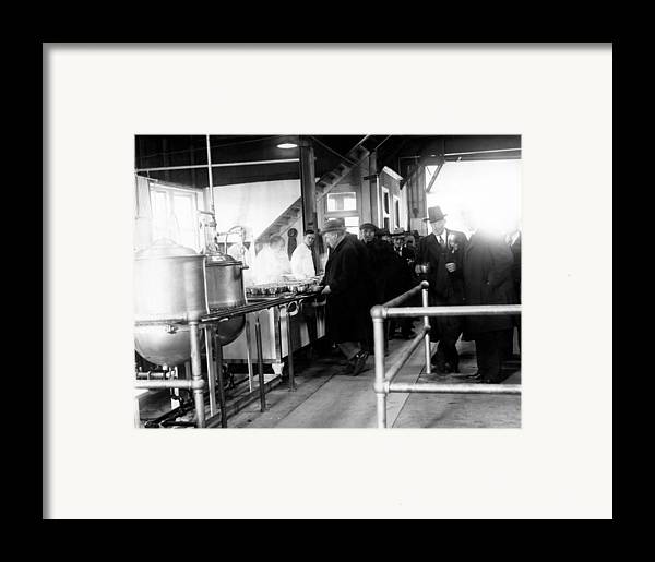 1930s Framed Print featuring the photograph Men Wait In Line For Food by Everett