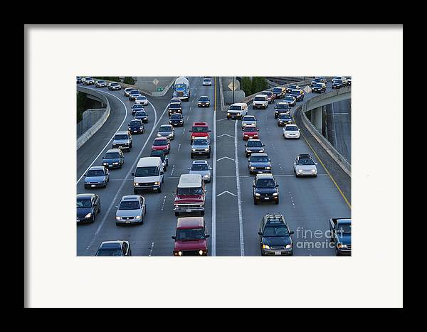 Cars Framed Print featuring the photograph Merging Traffic by Jeremy Woodhouse