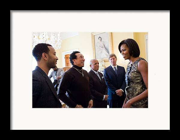 History Framed Print featuring the photograph Michelle Obama Greets John Legend by Everett