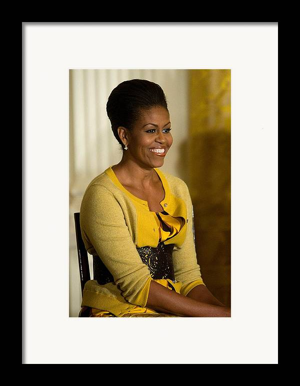 Michelle Obama Framed Print featuring the photograph Michelle Obama Wearing A J. Crew by Everett