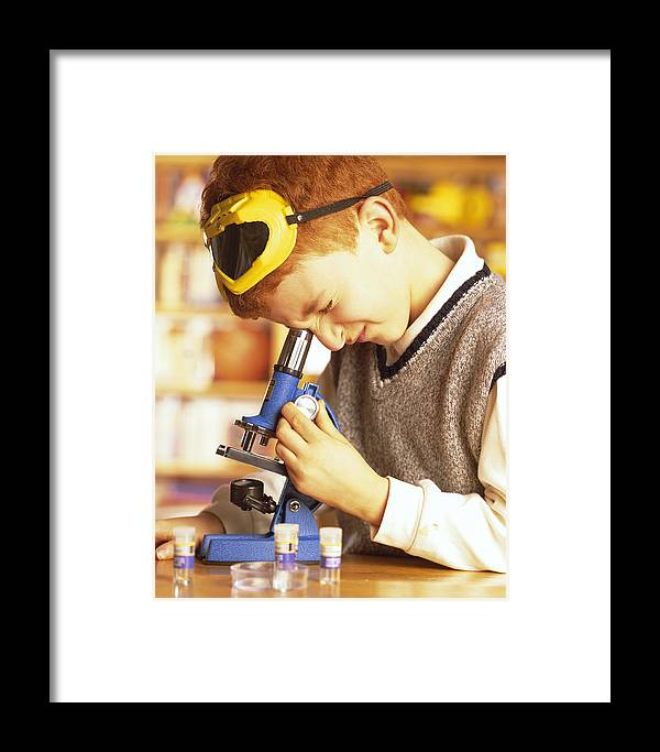 Child Framed Print featuring the photograph Microscope Use by Mauro Fermariello
