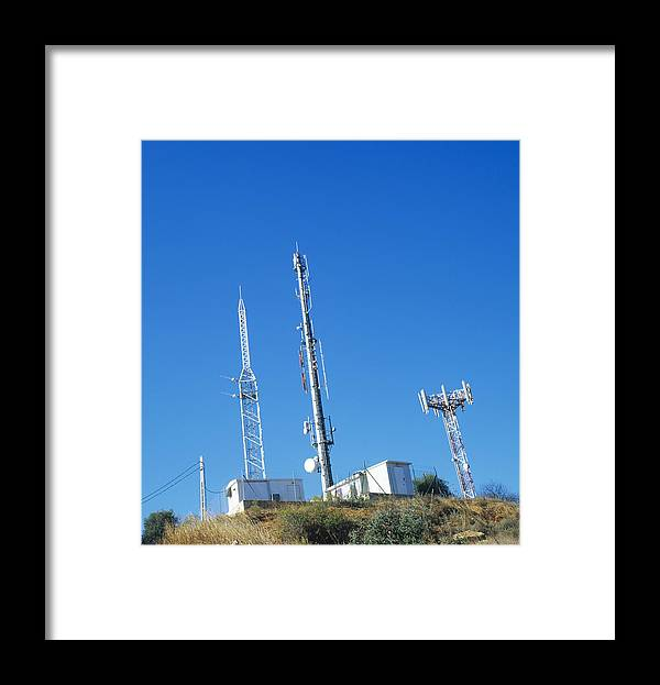 Mobile Phone Mast Framed Print featuring the photograph Mobile Phone Masts by Carlos Dominguez