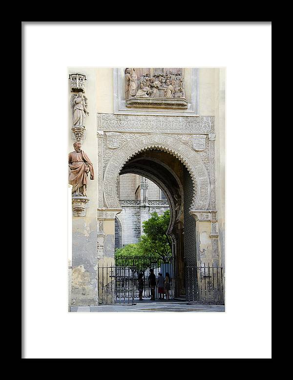 Moorish Framed Print featuring the photograph Moorish Arch Of The Giralda In Seville by Perry Van Munster