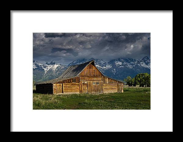 Grand Tetons Framed Print featuring the photograph Mormon Barn Under Approaching Storm by Greg Nyquist