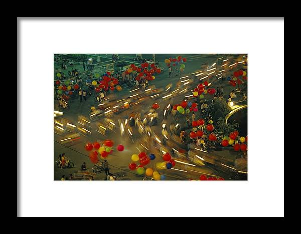 Balloons Framed Print featuring the photograph Motobikes Race Along A Street by Paul Chesley