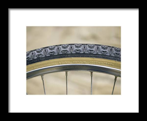 Equipment Framed Print featuring the photograph Mountain Bike Tyre by Andrew Lambert Photography
