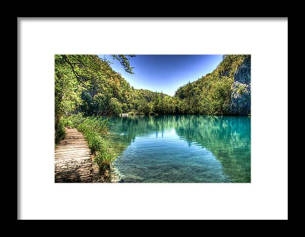 Islands Framed Print featuring the photograph Mountain Lake by Andrea Barbieri