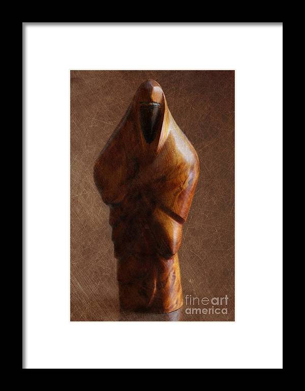 Muslim Framed Print featuring the photograph Muslim Figurine by Sophie Vigneault