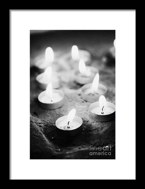 Candles Framed Print featuring the photograph Offering Candles Burning In A Church by Joe Fox