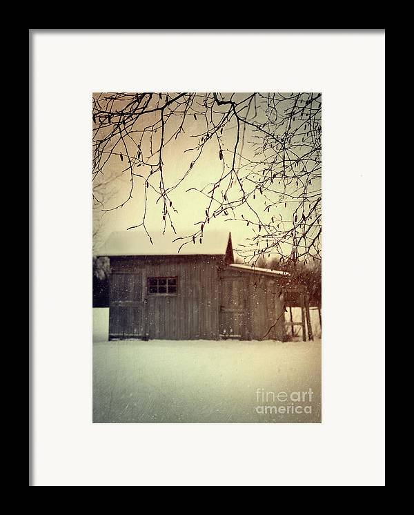 Atmospheric Framed Print featuring the photograph Old Shed In Wintertime by Sandra Cunningham
