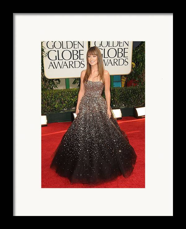 Olivia Wilde Framed Print featuring the photograph Olivia Wilde Wearing A Marchesa Gown by Everett