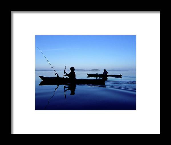 Kayakers Framed Print featuring the photograph On The Deep Blue Sea by Lorraine Devon Wilke