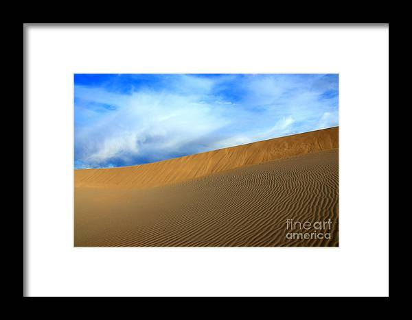 Sand Framed Print featuring the photograph On The Edge by Bob Christopher