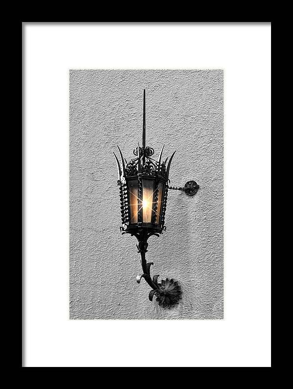 Lighting Framed Print featuring the photograph Outdoor Wall Lamp Aglow by Linda Phelps
