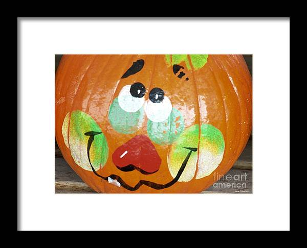 Painted Pumpkin 3 Framed Print featuring the photograph Painted Pumpkin 3 by Maria Urso