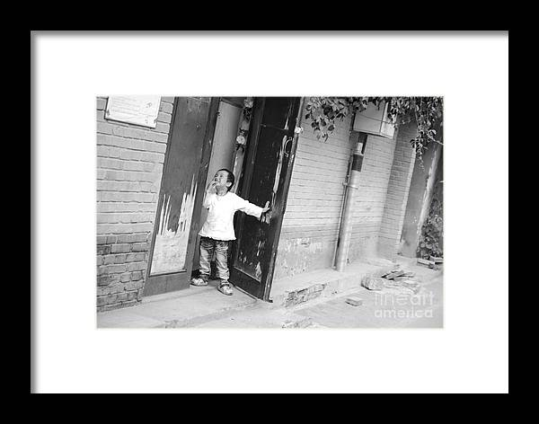 Beijing Framed Print featuring the photograph Peeking Out From Door by Jacob Smith