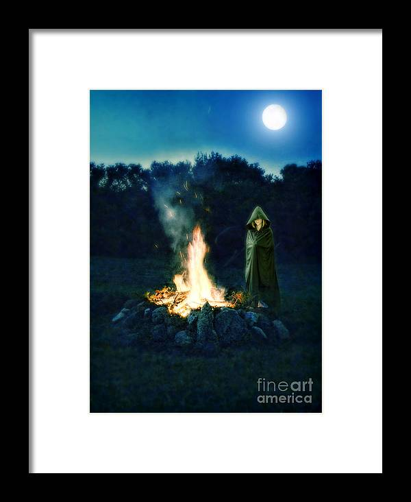 Fire Framed Print featuring the photograph Person Standing By A Bonfire In The Moonlight by Jill Battaglia