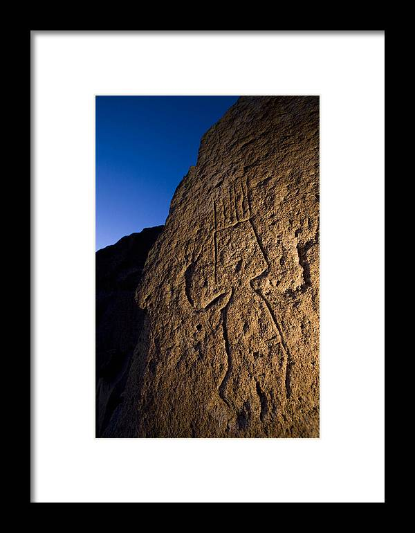 Petroglyphs Framed Print featuring the photograph Petroglyphs Are Seen At Twilight by Ralph Lee Hopkins