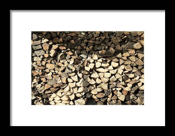 Log Framed Print featuring the photograph Pile Of Logs by Paul Biddle