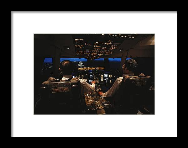 Indoors Framed Print featuring the photograph Pilots In The Cockpit Of An Aircraft by Paul Chesley