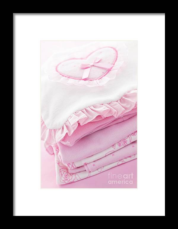 Baby Clothes Framed Print featuring the photograph Pink Baby Clothes For Infant Girl by Elena Elisseeva