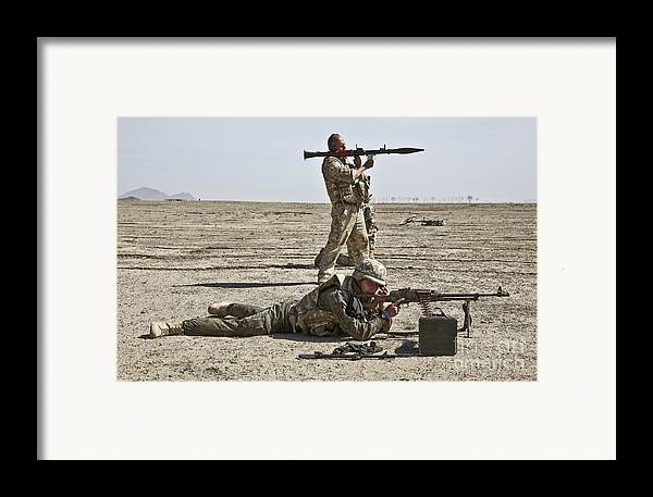 Moqur Framed Print featuring the photograph Polish Soldiers Prepare To Fire by Stocktrek Images