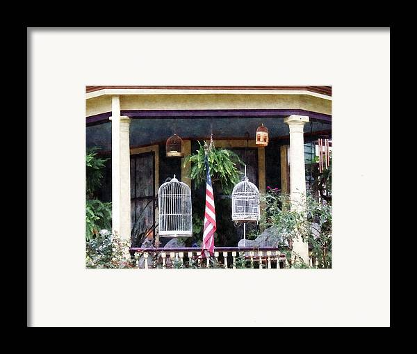 Porch Framed Print featuring the photograph Porch With Bird Cages by Susan Savad