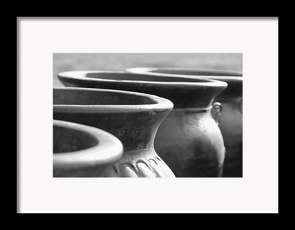 Terracotta Framed Print featuring the photograph Pots In Black And White by Kathy Clark