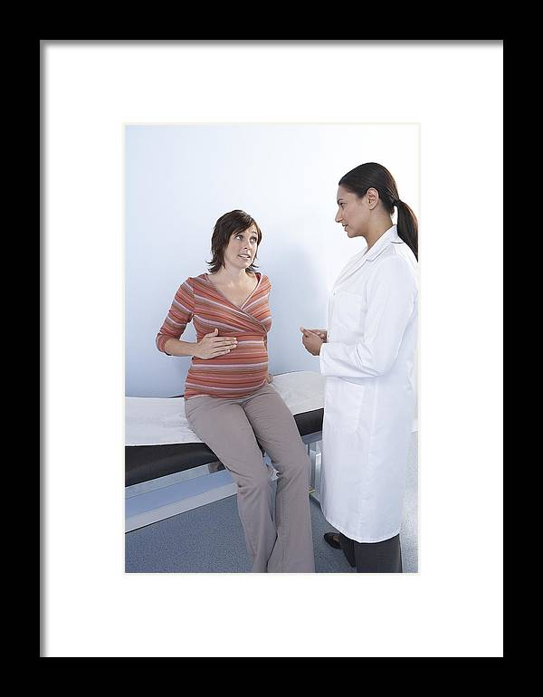 Human Framed Print featuring the photograph Pregnancy Consultation by Adam Gault