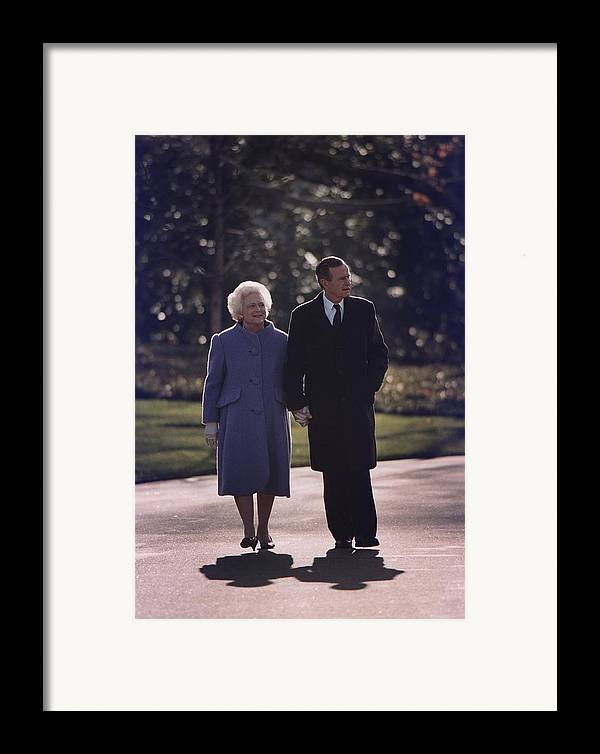 History Framed Print featuring the photograph President George And Barbara Bush Take by Everett